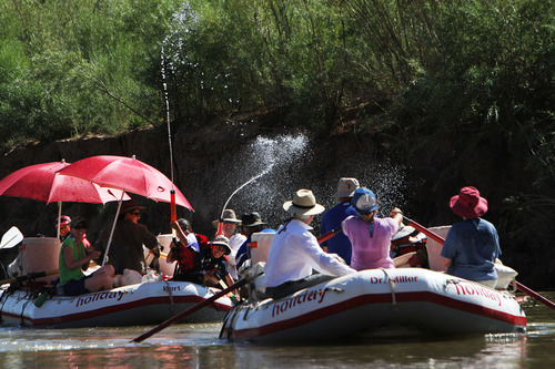 Francisco Kjolseth  |  The Salt Lake Tribune One of many water fights erupts in the hot July sun during a float with Holiday River Expeditions down Cataract Canyon in Canyonlands in the summer of 2012.