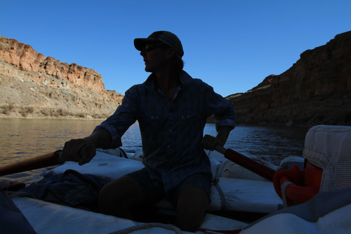 Francisco Kjolseth  |  The Salt Lake Tribune Holiday river guide Brin Finnigan settles into a rhythm as the morning sun casts dark shadows during the first day of a float into Cataract Canyon in July 2012.
