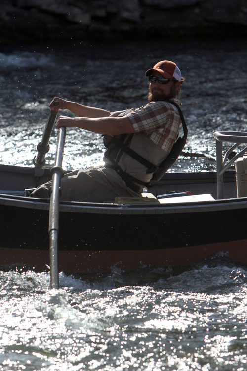 Francisco Kjolseth  |  The Salt Lake Tribune Western Rivers Fly Fisher guide Matt Lucas brings the boat around after navigating one of the shallow rapids on the B section of the Green River, from Little Hole to Indian Crossing, in April of 2013.