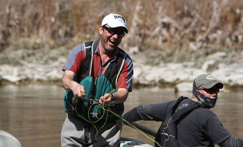 Francisco Kjolseth  |  The Salt Lake Tribune Joey Prokop finds himself tangled up as river guide Brad Lovejoy looks on during a float down the Green River in April of 2013.