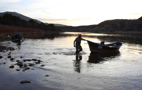 Francisco Kjolseth     The Salt Lake Tribune A long day on the river comes to a close as river guides move boats into position to pack onto trailers following a float down the B section of the Green River, from Little Hole to Indian Crossing.