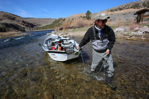 Francisco Kjolseth  |  The Salt Lake Tribune Western Rivers Fly Fisher guide Eli Koles positions his dory before the start of a new trip down the Green River.