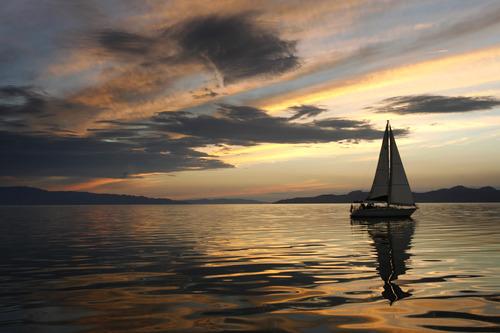 Rick Egan    The Salt Lake Tribune   Tim Loveday enjoys the last light of the day on the Great Salt Lake, in his Tartan 34,  Wednesday, August 22, 2012.