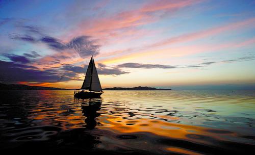 Rick Egan  | The Salt Lake Tribune   Tim Loveday enjoys the last light of the day on the Great Salt Lake, in his Tartan 34,  Wednesday, Aug. 22, 2012.