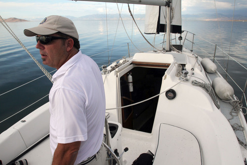 Francisco Kjolseth     The Salt Lake Tribune Captain James Anderson with Sailing Solution charters and lessons keeps an eye on a regatta race in August of 2012.