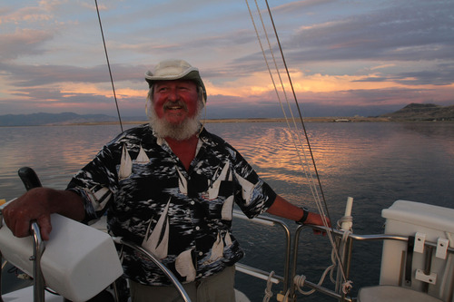 Francisco Kjolseth  |  The Salt Lake Tribune Captain J.R. Reynolds with the Great Salt Lake Experience enjoys the sunset last fall. As far as J.R. is concerned every day of the year is a good time to sail the Great Salt Lake.