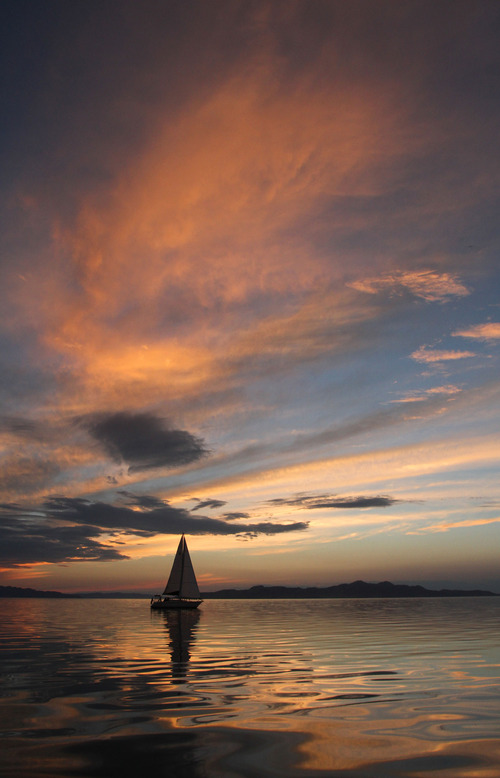 Francisco Kjolseth     The Salt Lake Tribune A boat gently drifts on the Great Salt Lake in August of 2012, as the sun sets on another beautiful day on the water.