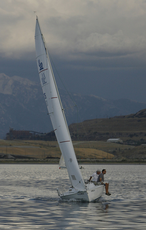 Francisco Kjolseth     The Salt Lake Tribune A boat tips in the wind during a regatta sailing race on the Great Salt Lake on Wednesday, August 22, 2012.