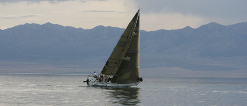 Francisco Kjolseth  |  The Salt Lake Tribune A boat tips in the wind during a regatta sailing race on the Great Salt Lake on Wednesday, August 22, 2012.
