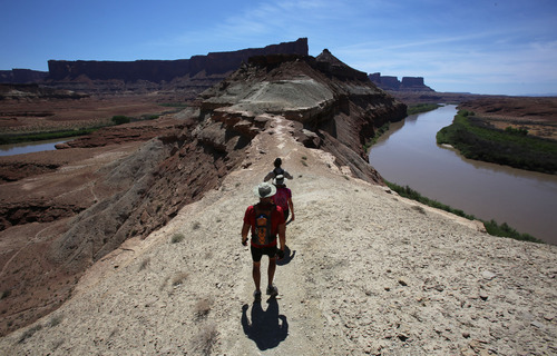 Francisco Kjolseth     The Salt Lake Tribune Hikers return to their mountain bikes after visiting the Fort Bottom ruins along the Green River along the White Rim Trail in Canyonlands National Park in May 2013.