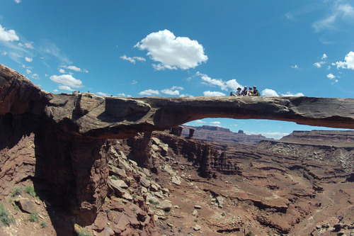 Francisco Kjolseth     The Salt Lake Tribune From left to right, Nancy Green, Marcia Walker, Tammi Messersmith, and Clari Higginson hang out on top of Musselman Arch along the White Rim Trail in Canyonlands National Park in May 2013.