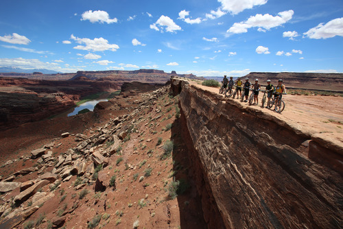 Francisco Kjolseth  |  The Salt Lake Tribune Mountain bikers on a Holiday Expeditions mountain bike tour take in the scene at the Colorado River overlook during a White Rim Trail trip in Canyonlands Natioanl Park in May 2013.