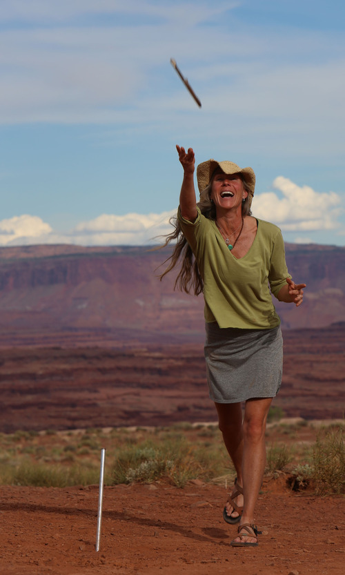Francisco Kjolseth  |  The Salt Lake Tribune Clari Higginson of Salt Lake City throws horseshoes at the Airport Campground during a mountain biking trip with Holiday Expeditions on the White Rim trail in Canyonlands National Park in May 2013.