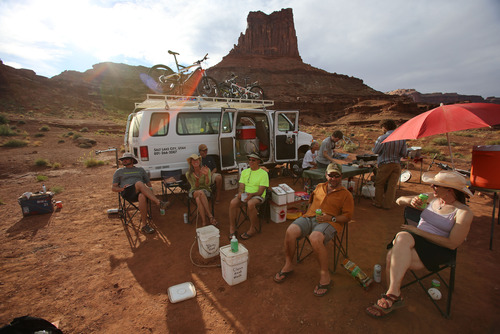 Francisco Kjolseth  |  The Salt Lake Tribune Riders at the Airport Campground reflect on the first day of a mountain bike trip with Holiday Expeditions on the White Rim Trail in Canyonlands National Park in May 2013.
