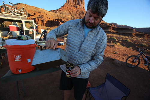 Francisco Kjolseth  |  The Salt Lake Tribune Tribune outdoors writer Brett Prettyman gets resourceful despite forgetting his coffee mug at home as the first day rises on a four-day trip along the White Rim in late May of 2013.