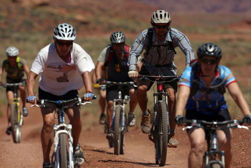 Francisco Kjolseth  |  The Salt Lake Tribune The social aspect of a mountain bike trip through Holiday Expeditions on the White Rim Trail in Canyonlands National Park is just one of the many highlights of the adventure.