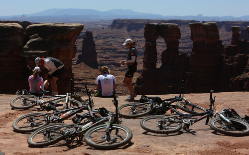 Francisco Kjolseth  |  The Salt Lake Tribune Riders on the White Rim Trail in Canyonlands National Park take a water break and take in some of the amazing scenery of the area.