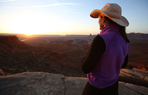 Francisco Kjolseth  |  The Salt Lake Tribune Tammi Messersmith of Salt Lake City takes in the sunset from the top of Murphy's Campground on the White Rim Trail in Canyonlands National Park in May 2013.