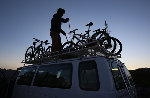 Francisco Kjolseth  |  The Salt Lake Tribune Holiday Expeditions guide Dave Snee gets mountain bikes ready for the third day of a four-day trip at Murphy's Campground on the White Rim Trail in Canyonlands National Park in May 2013.