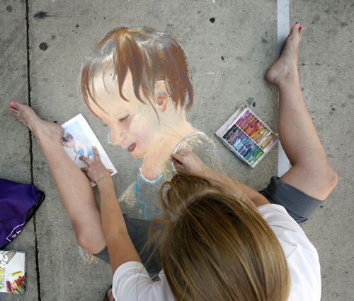 Rick Egan  |  The Salt Lake Tribune  Mary E. Jensen draws a picture of her niece at the Utah Foster Care Foundation's Annual Chalk Art Festival, at The Gateway in Salt Lake City, Friday, June 15, 2012.  The festival continues through Saturday.