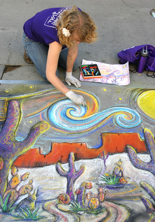Rick Egan  |  The Salt Lake Tribune  Sarah Winkler works on a drawin, Friday, June 14, 2013. More than 140 chalk artists created works of art on the pavement at The Gateway Friday.