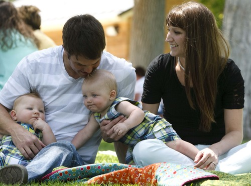 Leah Hogsten     The Salt Lake Tribune Phillip Bassett, wife Kristina and twins Hudson (left) and Noelan (right), 9 months, of Mona, will celebrate Father's Day for the first time since the military staff sergeant's sons were born while he was deployed in Afghanistan. The family plays in Spanish Fork park, June 13, 2013.