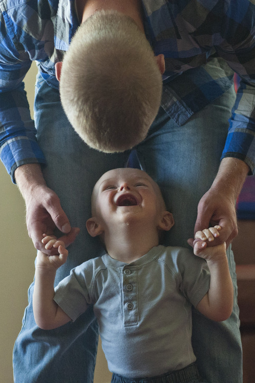 Chris Detrick     The Salt Lake Tribune Jason Call plays with his son Corver in Delta Tuesday June 11, 2013. Corver was born 10 months ago while Jason was serving in Afghanistan with Utah Army National Guard's 624th Engineer Company.