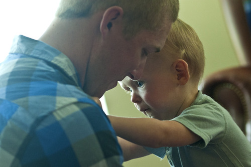 Chris Detrick  |  The Salt Lake Tribune Jason Call plays with his son Corver in Delta Tuesday June 11, 2013. Corver was born 10 months ago while Jason was serving in Afghanistan with Utah Army National Guard's 624th Engineer Company.