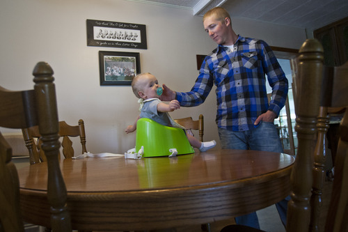 Chris Detrick     The Salt Lake Tribune Jason Call feeds his son Corver in Delta Tuesday June 11, 2013. Corver was born 10 months ago while Jason was serving in Afghanistan with Utah Army National Guard's 624th Engineer Company.