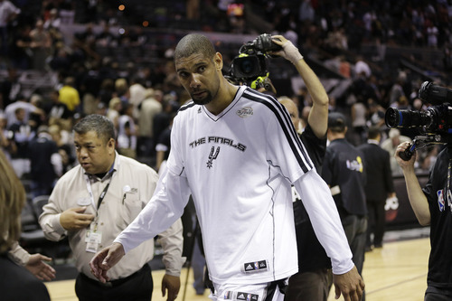 San Antonio Spurs' Tim Duncan leaves the floor after Game 5 of the NBA Finals basketball series against the Miami Heat, Sunday, June 16, 2013, in San Antonio. The Spurs won 114-104. (AP Photo/Eric Gay)