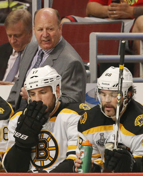 Boston Bruins coach Claude Julien reacts after a goal by the Chicago Blackhawks in the first period during Game 2 of the NHL hockey Stanley Cup Finals, Saturday, June 15, 2013, in Chicago. (AP Photo/Nam Y. Huh)