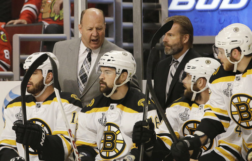 Boston Bruins head coach Claude Julien talks to his team during the first period of Game 1 in their NHL Stanley Cup Final hockey series against the Chicago Blackhawks, Wednesday, June 12, 2013, in Chicago. (AP Photo/Nam Y. Huh)