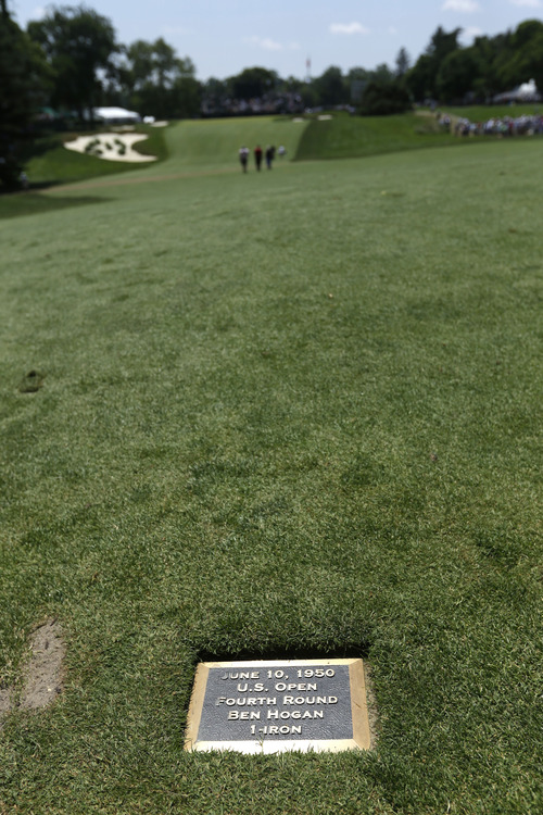 A plaque commemorating Ben Hogan's fourth round U.S. Open shot on the 18th hole in 1950 is shown during practice for the U.S. Open golf tournament at Merion Golf Club, Wednesday, June 12, 2013, in Ardmore, Pa. (AP Photo/Darron Cummings)