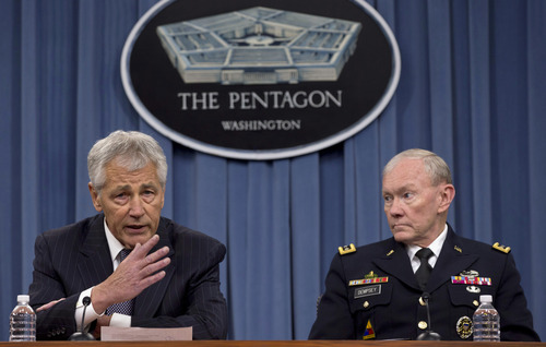 FILE – In this May 17, 2013 file photo Defense Secretary Chuck Hagel, left, and Chairman of the Joint Chiefs of Staff, Gen. Martin Dempsey take turns talking to media during a news conference at the Pentagon. Women may be able to begin training as Army Rangers by mid-2015, and as Navy SEALs a year later under broad plans Defense Secretary Chuck Hagel is approving that would slowly bring women into thousands of combat jobs, including those in the country's elite special operations forces, according to details of the plans submitted to Hagel that were obtained by The Associated Press.  (AP Photo/Carolyn Kaster, File)