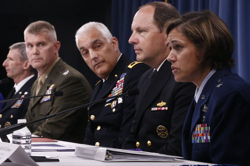 Air Force Brig. Gen. Gina M. Grosso, right, speaks during a news conference at the Pentagon, Tuesday, June 18, 2013, to discuss women in combat. From right to left are: Grosso, Navy Rear Adm. Tony Kurta, Army Maj. Gen. Bennet Sacolick, Marine Col. Jon Aytes, and Army Deputy Chief of Staff Lt. Gen. Howard B. Bromberg. The military services announced their plans to break down the final barriers for women, opening up thousands of combat jobs including the elite Army Rangers and Navy SEAL.(AP Photo/Charles Dharapak)