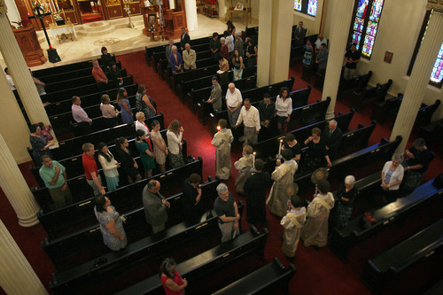 Scott Sommerdorf   |  The Salt Lake Tribune Worshippers cross themselves as the procession passes during the service at Holy Trinity Greek Orthodox Cathedral, Sunday, Sunday, June 9, 2013.