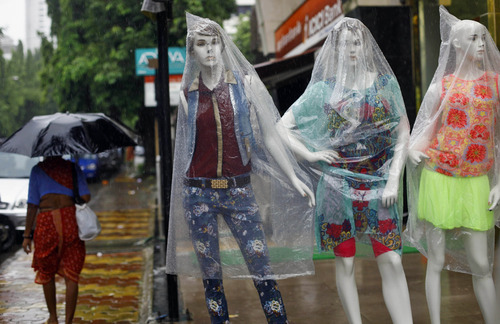 Mannequins are covered with plastic as it rains in Mumbai, India, Tuesday, June 18, 2013. The monsoon rains which usually hit India from June to September are crucial for farmers whose crops feed hundreds of millions of people. (AP Photo/Rafiq Maqbool)