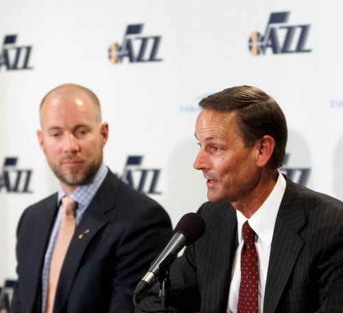 Trent Nelson  |  The Salt Lake Tribune Mike Young, right, of Young Electric Sign Company, speaks as the Utah Jazz announce a series of improvements to EnergySolutions Arena Monday June 17, 2013 in Salt Lake City. At left is Steve Miller, chief operating officer of Miller Sports Properties.