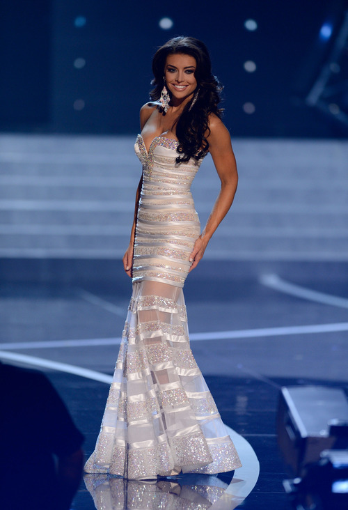 Miss Utah Marissa Powell walks onstage during the Miss USA 2013 pageant, Sunday, June 16, 2013, in Las Vegas. (AP Photo/Jeff Bottari)