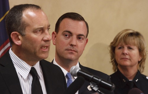 "Leah Hogsten  |  The Salt Lake Tribune West Valley City Mayor Mike Winder (center), flanked by City Manager Wayne Pyle and Anita Schwemmer, West Valley City's acting police chief, said the city must root out ""any and all impropriety"" and establish stronger independent oversight to get its troubled police department back on track at a press conference, April 23, 2013."