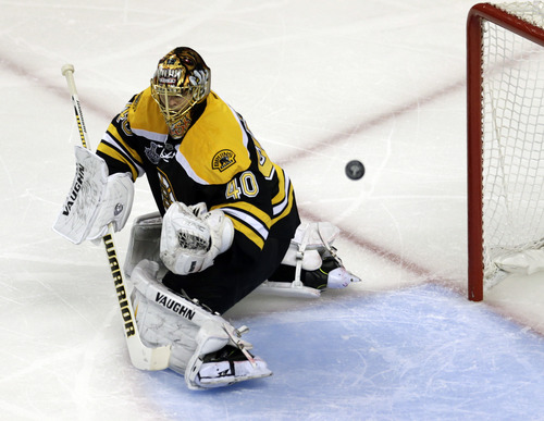 Boston Bruins goalie Tuukka Rask, of Finland, turns aside the puck shot by the Chicago Blackhawks during the second period in Game 3 of the NHL hockey Stanley Cup Finals in Boston, Monday, June 17, 2013. (AP Photo/Charles Krupa)
