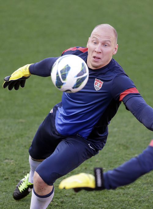 U.S. national soccer team goalkeeper Brad Guzan reaches for a ball during a practice session Monday, June 17, 2013, in Sandy, Utah. The U.S. will face Honduras on Tuesday, June 18, 2013, for a World Cup qualifier soccer match. (AP Photo/Rick Bowmer)