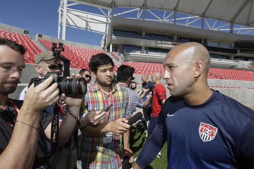 U.S. national soccer team goalkeeper Tim Howard, right, talks with reporters before the start of a practice session, Monday, June 17, 2013, in Sandy, Utah. The U.S. will face Honduras on Tuesday, June 18 for a World Cup qualifier soccer match. (AP Photo/Rick Bowmer)