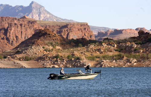 Al Hartmann  |  The Salt Lake Tribune Fishemen work the area near the Horn at Lake Powell.