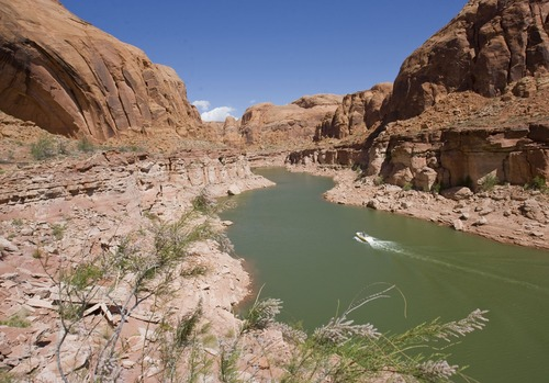 Al Hartmann  |  Tribune file photo The proposed pipeline project would take water from Lake Powell in southeastern Utah and move it to populations centers in southwestern Utah. In this file photo, fishing boat heads up Sevenmile Canyon at Lake Powell.