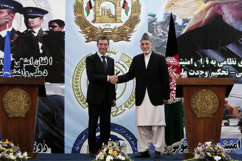 Afghan President Hamid Karzai, right, shakes hands with NATO Secretary-General Anders Fogh Rasmussen after a press conference during a ceremony at a military academy on the outskirts of Kabul, Afghanistan, Tuesday, June 18, 2013. Afghan forces have taken over the lead from the U.S.-led NATO coalition for security nationwide, Karzai announced in the significant milestone in the 12-year war. (AP Photo/Rahmat Gul)