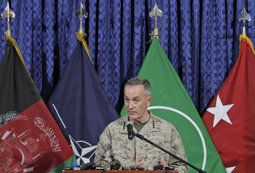 Top U.S. military commander in Afghanistan, Joseph Dunford, talks to media representatives at the ISAF headquarters in Kabul, Afghanistan, Tuesday, June, 18, 2013. Dunford said NATO will support any positive movement to bring reconciliation between the afghan people and Taliban. (AP Photo/Ahmad Jamshid)