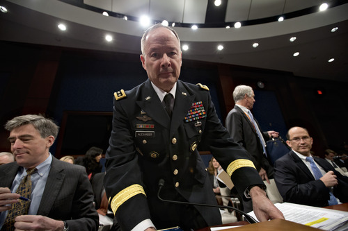 Gen. Keith B. Alexander, director of the National Security Agency and head of the U.S. Cyber Command, arrives to testify before the House Permanent Select Committee on Intelligence on Capitol Hill in Washington, Tuesday, June 18, 2013. Amid revelations that the electronic surveillance agency is sweeping up Americans' phone and Internet records in its quest to investigate terrorist threats, President Barack Obama defended top secret National Security Agency spying programs as legal during an interview yesterday, and called them transparent — even though they are authorized in secret. From left to right are Chris Inglis, deputy director of the National Security Agency, Gen. Keith B. Alexander, director of NSA, and Deputy Director of the FBI Sean Joyce.  (AP Photo/J. Scott Applewhite)