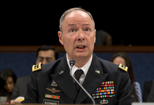 Gen. Keith B. Alexander, director of the National Security Agency and head of the U.S. Cyber Command, testifies before the House Permanent Select Committee on Intelligence, on Capitol Hill in Washington, Tuesday, June 18, 2013. Amid revelations that the electronic surveillance agency is sweeping up Americans' phone and Internet records in its quest to investigate terrorist threats, President Barack Obama defended top secret National Security Agency spying programs as legal during an interview yesterday, and called them transparent — even though they are authorized in secret.  (AP Photo/J. Scott Applewhite)