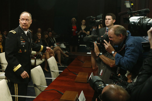National Security Agency (NSA) Director Gen. Keith B. Alexander approaches the witness table on Capitol Hill in Washington, Tuesday, June 18, 2013,  to testify before the House Intelligence Committee hearing regarding NSA surveillance. (AP Photo/Charles Dharapak)